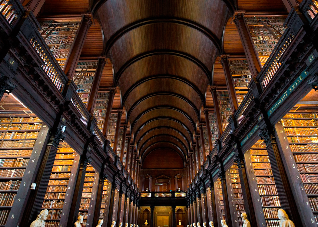 Spectacular view on the bookshelves from floor to ceiling in a two-storeyed library or archive