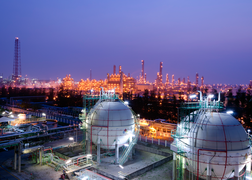 Picture displays a top view on a petrochemical object in the evening